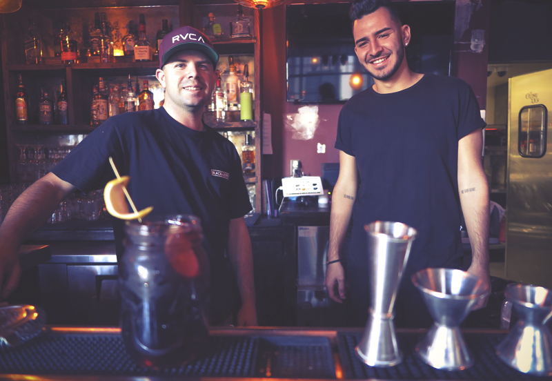 Bartenders serving up cocktails at the Gypsy Den.