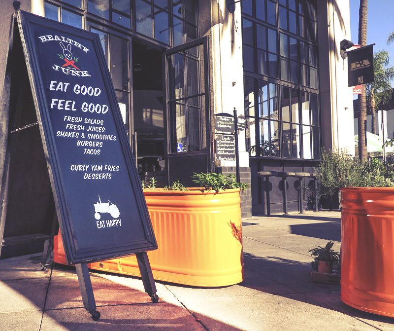 """Eat Good, Feel Good"" sign outside of Healthy Junk restaurant in Anaheim."