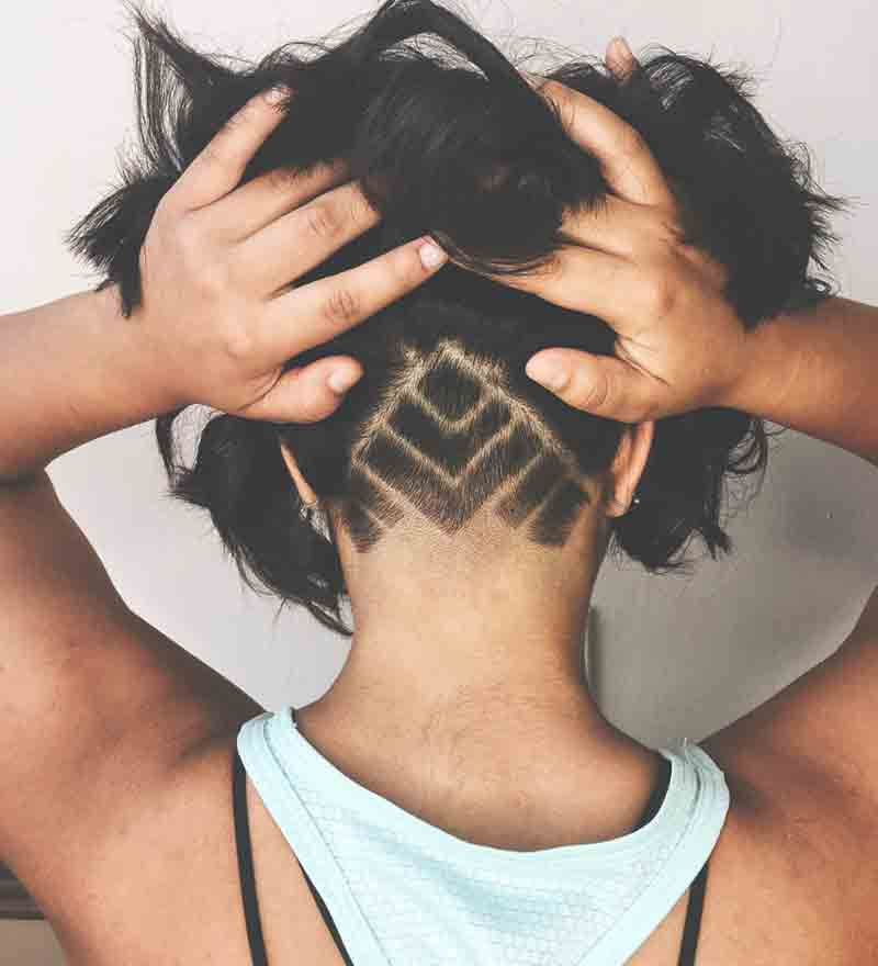 Woman showing off fresh, funky hair cut styled by Remedy Hair Shoppe.