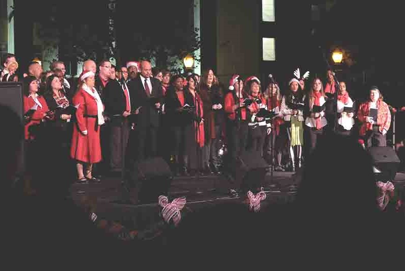 Christmas carolers singing at a holiday show in Anaheim.