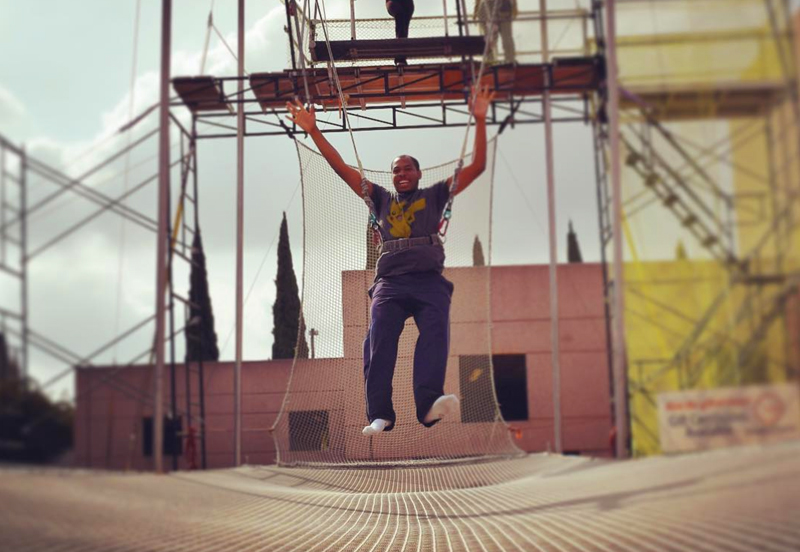 man practicing trapeze at Swing It Trapeze in Anaheim.