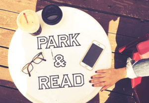 """""""Park & Read"""" sign at Ink and Bean Cafe's weekly Writer's Night."""